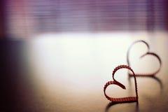 Το τονισμένο κερί μορφής καρδιών αγάπης Στοκ Φωτογραφία