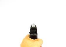 Το τράβηγμα ένα πυροβόλο όπλο ώθησης απομονώνει bakground Στοκ Φωτογραφία