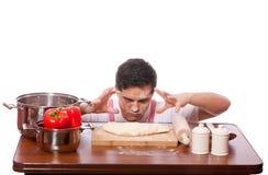 Το λυπημένο άτομο προσπαθεί στο μαγείρεμα. Στοκ εικόνα με δικαίωμα ελεύθερης χρήσης