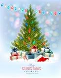 Το υπόβαθρο διακοπών με ένα χριστουγεννιάτικο δέντρο και παρουσιάζει ελεύθερη απεικόνιση δικαιώματος