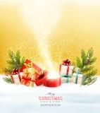 Το υπόβαθρο διακοπών Χριστουγέννων με παρουσιάζει και μαγικό κιβώτιο ελεύθερη απεικόνιση δικαιώματος
