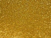 Το υπόβαθρο της χρυσής σύστασης λάμπει στοκ φωτογραφίες