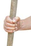 Το χέρι αγροτών κρατά το παλαιό ξύλινο ρόπαλο Στοκ Φωτογραφίες