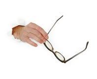 το χέρι ανασκόπησης glasse κρατά ά στοκ φωτογραφία με δικαίωμα ελεύθερης χρήσης