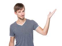 Το χέρι ατόμων παρουσιάζει με το κενό σημάδι Στοκ Φωτογραφία