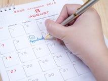 Το χέρι γυναικών γράφει το διορισμό στο ημερολόγιο 3 Στοκ φωτογραφία με δικαίωμα ελεύθερης χρήσης