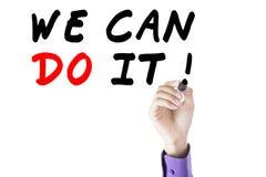 Το χέρι επιχειρηματιών γράφει ότι μπορούμε να το κάνουμε Στοκ Εικόνες