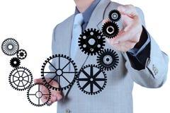 Το χέρι επιχειρηματιών σύρει το εργαλείο στην έννοια επιτυχίας Στοκ Εικόνες