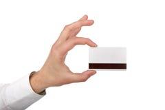 το χέρι καρτών κρατά το άτομ&omicro Στοκ Εικόνες