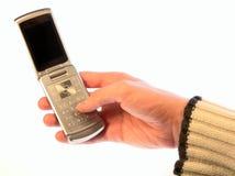 το χέρι κινητών τηλεφώνων απ&omi Στοκ φωτογραφία με δικαίωμα ελεύθερης χρήσης