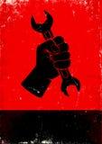 Το χέρι κρατά ένα γαλλικό κλειδί Στοκ φωτογραφία με δικαίωμα ελεύθερης χρήσης