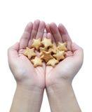 Το χέρι κρατά τα μπισκότα Στοκ Εικόνα