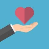 Το χέρι κρατά την καρδιά ελεύθερη απεικόνιση δικαιώματος