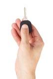 Το χέρι κρατά το κλειδί αυτοκινήτων στοκ φωτογραφίες