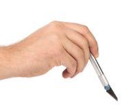 Το χέρι κρατά το μαχαίρι τεχνών αλουμινίου Στοκ εικόνες με δικαίωμα ελεύθερης χρήσης
