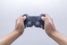 Το χέρι με το gamepad Στοκ Εικόνες