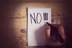 Το χέρι που κρατά μια μάνδρα και γράφει το αριθ.!! Στοκ Φωτογραφία