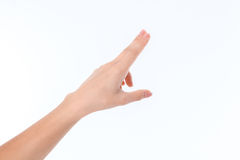 Το χέρι που παρουσιάζει τη χειρονομία με ξύνει το ένα το άλλο ο δείκτης και το μέσο δάχτυλό σας Στοκ φωτογραφία με δικαίωμα ελεύθερης χρήσης