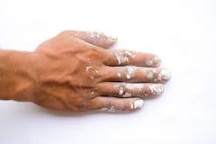 Το χέρι που χρωματίστηκε το λευκό λεκίασε. Στοκ φωτογραφία με δικαίωμα ελεύθερης χρήσης