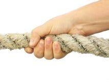 το χέρι τραβά το σχοινί που στοκ εικόνες με δικαίωμα ελεύθερης χρήσης