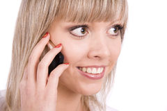 Το χαμογελώντας κορίτσι μιλά στο κινητό τηλέφωνο Στοκ εικόνες με δικαίωμα ελεύθερης χρήσης