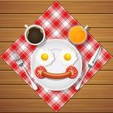 Το χαμόγελο αντέχει κάνει με τα τηγανισμένο αυγά και το λουκάνικο και το ποτό Στοκ Εικόνα