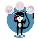 Το χαριτωμένο γατάκι στο τηλέφωνο και επιλέγει ένα δώρο Στοκ εικόνα με δικαίωμα ελεύθερης χρήσης