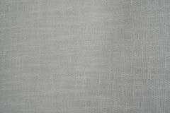Το χονδροειδές άσπρο ύφασμα κρεμά Στοκ φωτογραφίες με δικαίωμα ελεύθερης χρήσης