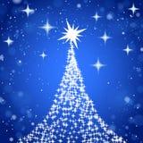 Το χριστουγεννιάτικο δέντρο με τα αστέρια λάμπει επάνω μπλε υπόβαθρο Στοκ Εικόνα