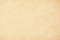 Το χρυσό έγγραφο υποβάθρου σύστασης στην κίτρινη εκλεκτής ποιότητας κρέμα ή το μπεζ χρωματίζει, έγγραφο περγαμηνής, αφηρημένη χρυ Στοκ Φωτογραφία