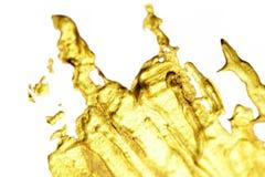 Το χρυσό αφηρημένο χέρι παφλασμών χρωμάτισε το χρυσό υπόβαθρο λεκέδων με στοκ εικόνες