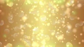 Το χρυσό bokeh ανάβει τα μόρια και starglow απόθεμα βίντεο