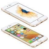 Το χρυσό iPhone της Apple 6s βρίσκεται στην επιφάνεια με iOS 9 Στοκ Εικόνα