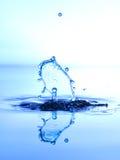 Το χρώμα waterdrops συγκρούεται μεταξύ τους Στοκ Εικόνα
