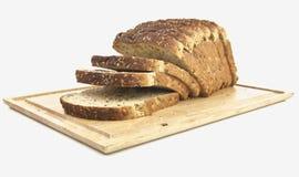 το ψωμί χαρτονιών που σπάρθηκε ξύλινο τεμάχισε Στοκ εικόνα με δικαίωμα ελεύθερης χρήσης