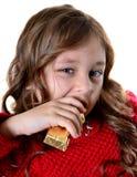 Το όμορφο κορίτσι τρώει Στοκ Φωτογραφίες