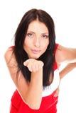 Το όμορφο χαριτωμένο brunette που φυσά εσείς φιλά απομονωμένος Στοκ φωτογραφίες με δικαίωμα ελεύθερης χρήσης