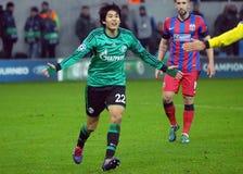 Το Atsuto Uchida αντιδρά κατά τη διάρκεια του παιχνιδιού UEFA Champions League Στοκ Εικόνες