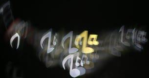 Το Bokeh διαμόρφωσε τις σημειώσεις για ένα σκοτεινό υπόβαθρο Στοκ Εικόνα