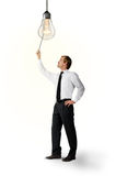 Το Businessmann ανοίγει το φως Στοκ Φωτογραφία