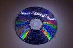 Το CD με τα σταγονίδια νερού κλείνει επάνω Στοκ φωτογραφίες με δικαίωμα ελεύθερης χρήσης