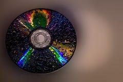 Το CD με τα σταγονίδια νερού κλείνει επάνω Στοκ εικόνες με δικαίωμα ελεύθερης χρήσης
