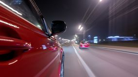 Το Drivelapse αστικό εξετάζει από οδηγώντας το γρήγορα αυτοκίνητο μια λεωφόρο νύχτας σε μια πόλη timelapse hyperlapse φιλμ μικρού μήκους