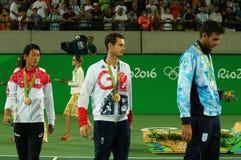 Το Kei Nishikori JPN Λ, ο ολυμπιακός πρωτοπόρος Andy Murray GBR και ο Juan Martin Del Πόρτο ARG κατά τη διάρκεια των ατόμων ` s α Στοκ Εικόνα
