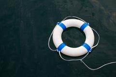 Το Lifebuoy, ζώνη ασφαλείας στην ασφάλεια στη θάλασσα όπως, βοηθά, ελπίδα, προστασία concep στοκ φωτογραφία