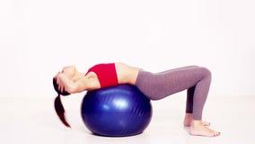 Το Pilates κάθεται επάνω την άσκηση απόθεμα βίντεο