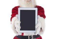 Το Santa παρουσιάζει ένα PC ταμπλετών Στοκ Εικόνα