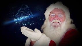 Το Santa που φυσά ακτινοβολεί διαμορφώνοντας το χαιρετισμό Χριστουγέννων φιλμ μικρού μήκους