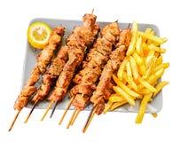 Το Souvlaki απομόνωσε τα ελληνικά etnic τρόφιμα μόνα που έψησε σε ένα πιάτο στοκ φωτογραφία με δικαίωμα ελεύθερης χρήσης