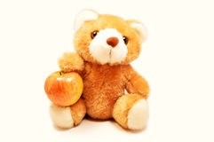Το Teddy αντέχει ένα μήλο Στοκ Εικόνα